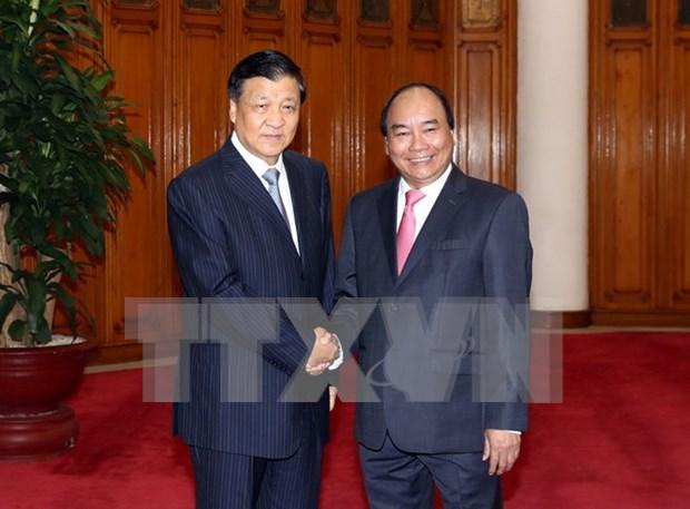 Vietnam concede importancia a amistad y asociacion de cooperacion con China hinh anh 1