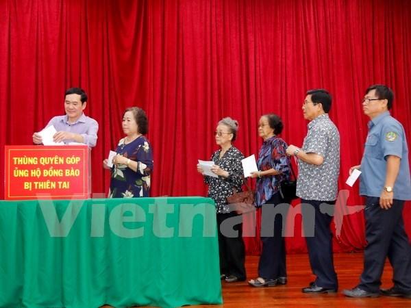 Comunidad vietnamita en Laos inicia campana de donacion para afectados por tifones hinh anh 1