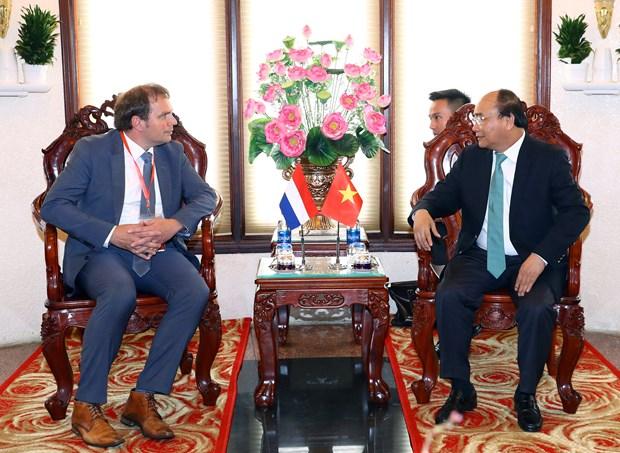 Premier de Vietnam aspira a aprender experiencias de Paises Bajos en respuesta al cambio climatico hinh anh 1