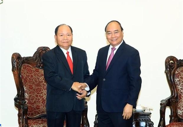 Premier de Vietnam encomia cooperacion con Laos en asuntos internos hinh anh 1