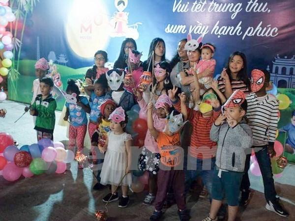 Celebran en Mozambique Fiesta del Medio Otono para ninos vietnamitas hinh anh 1