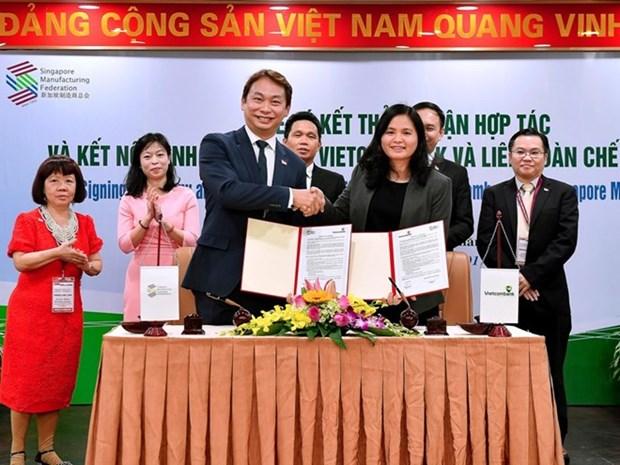 Vietcombank logra acuerdo con Federacion de Manufactura de Singapur hinh anh 1