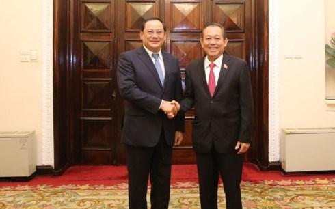Vicepremieres de Vietnam y Laos resaltan la amistad binacional hinh anh 1