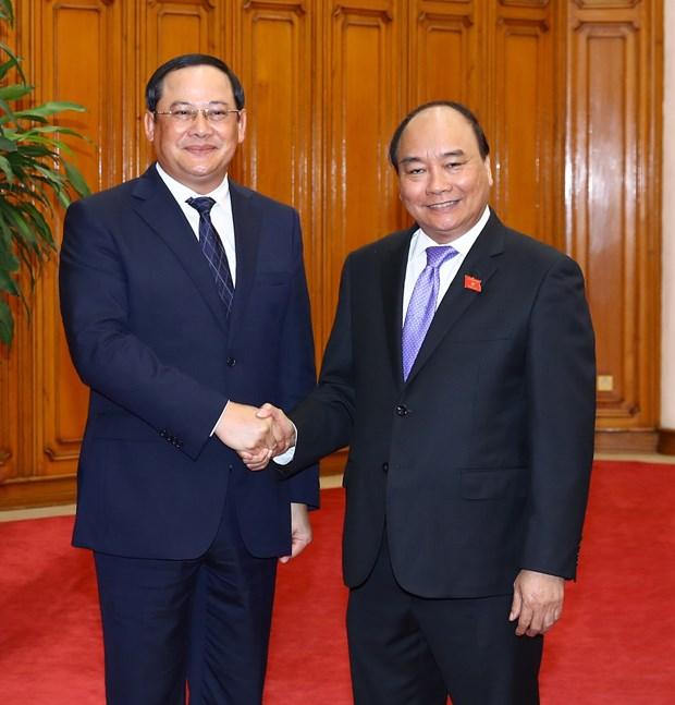 Premier de Vietnam propone acelerar proyectos de cooperacion inversionista con Laos hinh anh 1