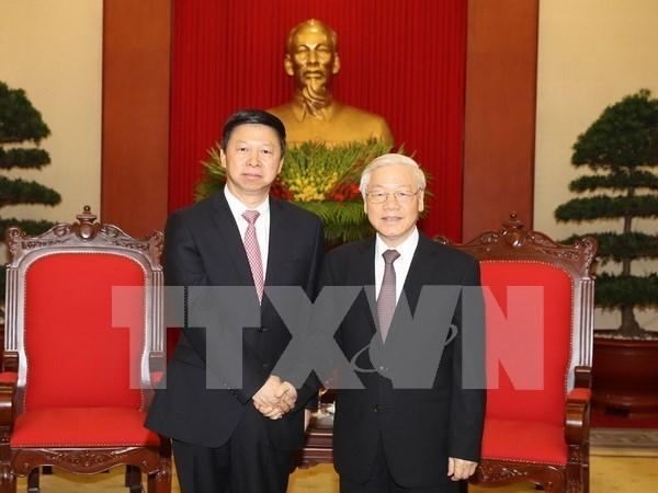 Secretario general de PCV recibe a enviado especial de maximo dirigente partidista de China hinh anh 1