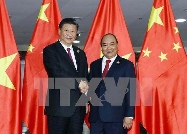 Premier vietnamita Nguyen Xuan Phuc sostiene encuentro con presidente chino, Xi Jinping hinh anh 1