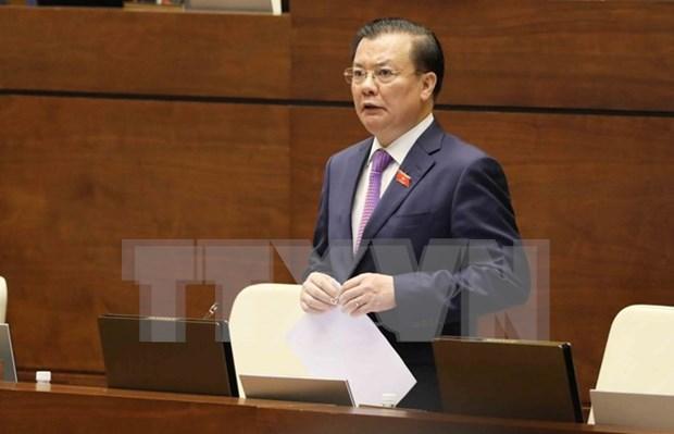 Diputados y electores vietnamitas complacidos con comparecencia del ministro de Finanzas hinh anh 1