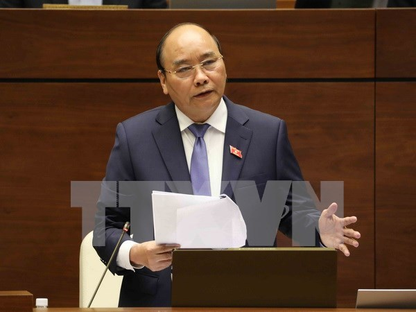 Premier de Vietnam comparece ante el Parlamento hinh anh 1