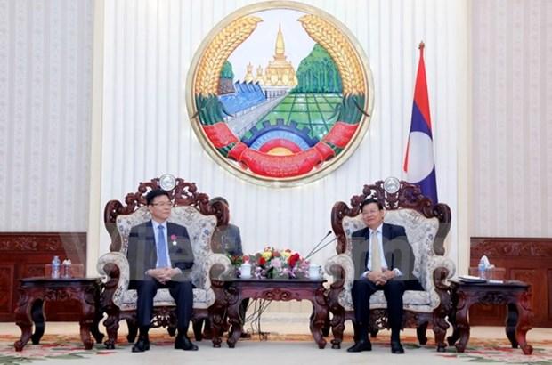 Premier laosiano destaca eficiencia de cooperacion juridica con Vietnam hinh anh 1