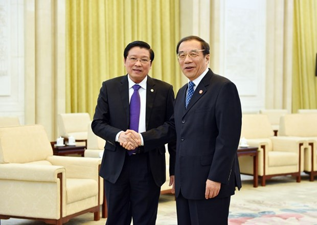 Delegacion del Partido Comunista de Vietnam visita China hinh anh 1