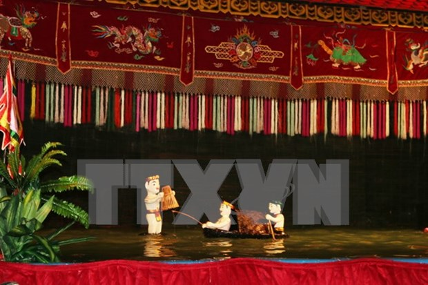 Arte de marionetas acuaticas vietnamitas conquista al publico frances hinh anh 1