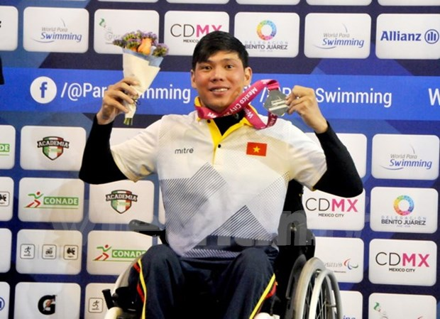 Vietnam gana medallas de plata en eventos deportivos mundiales para minusvalidos hinh anh 1