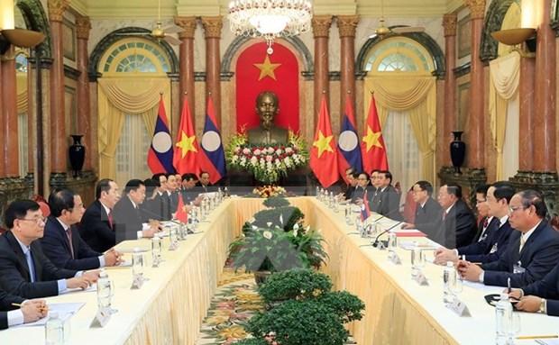 Presidente de Vietnam recibe a secretario general de PPRL y presidente de Laos hinh anh 1