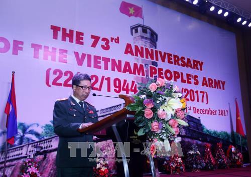 Conmemoran en Laos aniversario de Fundacion del Ejercito Popular de Vietnam hinh anh 1