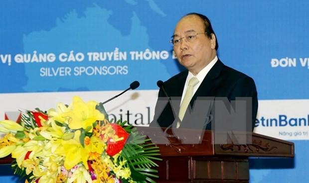 Premier vietnamita da instrucciones sobre desarrollo economico del 2018 hinh anh 1