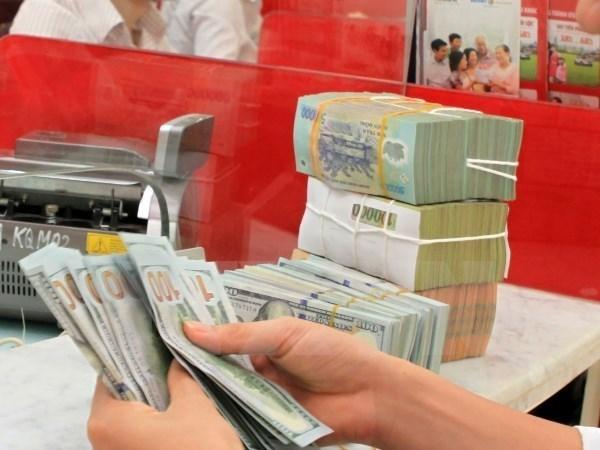Sacombank de Vietnam recupera 800 millones de dolares de deudas malas en 2017 hinh anh 1