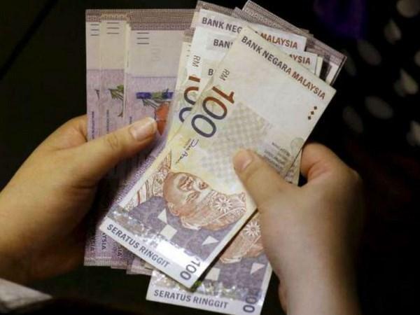 Malasia: Funcionarios publicos y jubilados reciben subsidio especial de gobierno hinh anh 1