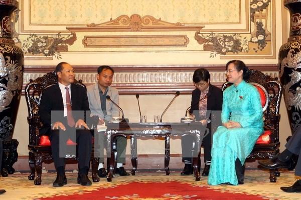 Ciudad Ho Chi Minh y localidades de Laos intercambian experiencias en gestion de tierras hinh anh 1