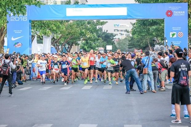 Ocho miles atletas participan en concurso internacional de maraton Ciudad Ho Chi Minh 2018 hinh anh 1