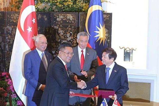 Singapur y Malasia firman acuerdo de transporte hinh anh 1