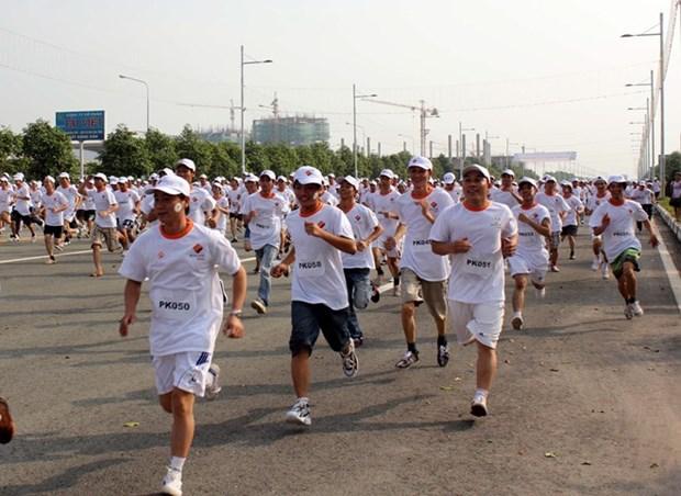 Dia de Carrera Olimpica en Vietnam refuerza conciencia publica sobre ejercicio fisico hinh anh 1