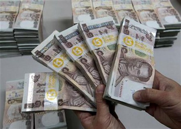 Exportadores tailandeses enfrentan dificultades ante aumento del valor de moneda nacional hinh anh 1