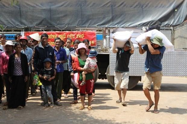 Distribuye arroz a personas de bajos ingresos en Vietnam en ocasion de Tet hinh anh 1