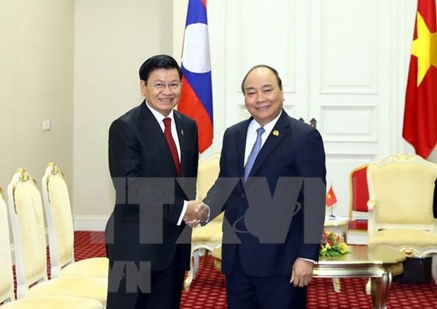 Vietnam y Laos, amigos tradicionales y contrapartes en cooperacion multifacetica hinh anh 1