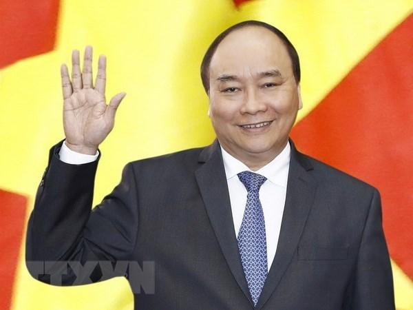 Premier vietnamita mantuvo encuentros con dirigentes partidista y estatal de Laos hinh anh 1