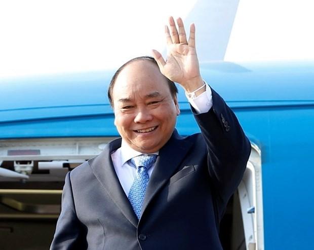 Premier de Vietnam concluye viaje a Laos para reunion del comite intergubernamental hinh anh 1