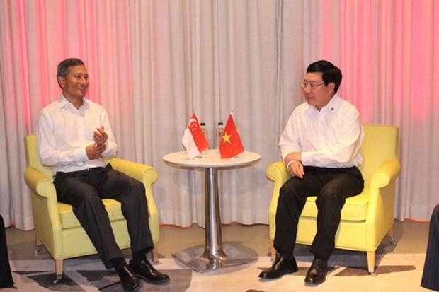 Singapur ayudara a Vietnam en gestion digital y cambio de industrias hinh anh 1