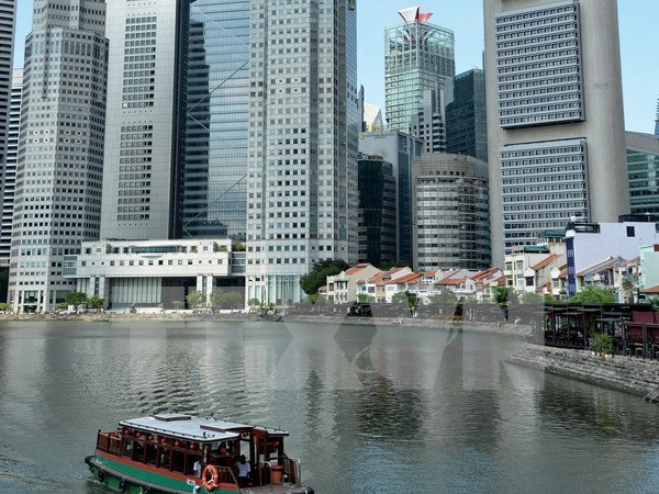 Malasia y Singapur establecen corredor de mercado hinh anh 1