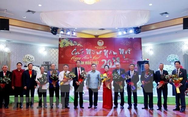 Organiza embajada vietnamita en Laos banquete para diplomaticos en ocasion del Tet hinh anh 1
