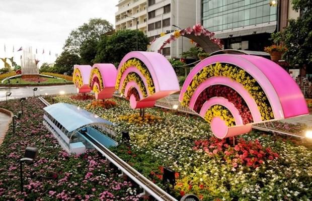 Abierta calle floral Nguyen Hue en Ciudad Ho Chi Minh en dias festivos del Tet hinh anh 1