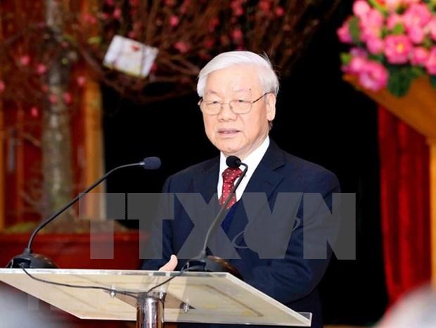 Maximo dirigente partidista felicita a colectivo de trabajadores de Oficina del Comite Central por el Tet hinh anh 1