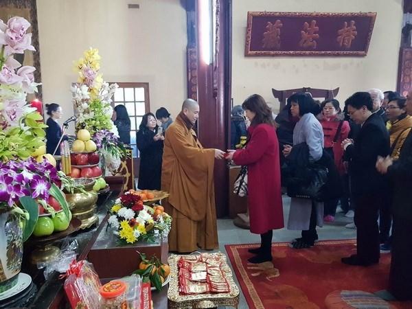 Vietnamitas en Venezuela y Francia celebran Ano Nuevo Lunar hinh anh 1