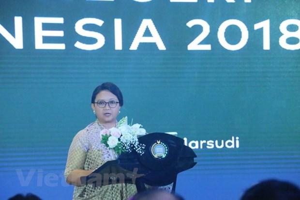 Indonesia y Singapur trabajan para fortalecer nexos economicos hinh anh 1