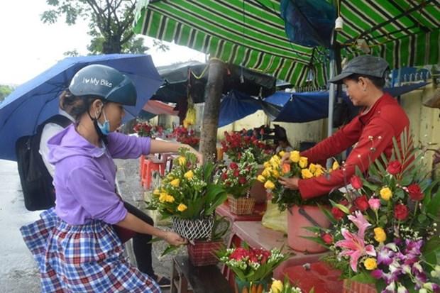 Desarrollan actividades en Vietnam en saludo al Dia Internacional de la Mujer hinh anh 1