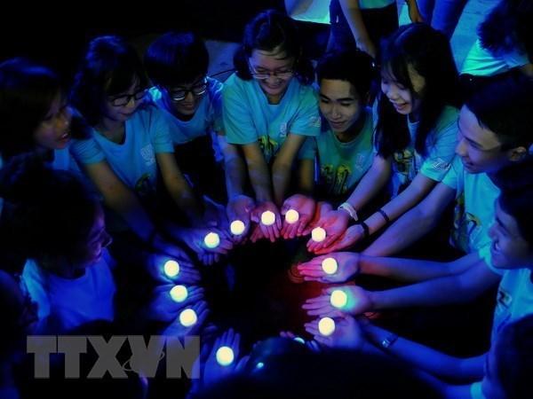 Actividades en respuesta a campana ambiental Hora del Planeta 2018 en Hanoi hinh anh 1
