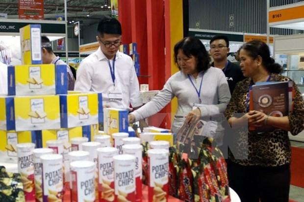 Exhibiciones sobre industrias del plastico y cauchera en Vietnam acaparan atencion de comunidad empresarial hinh anh 1