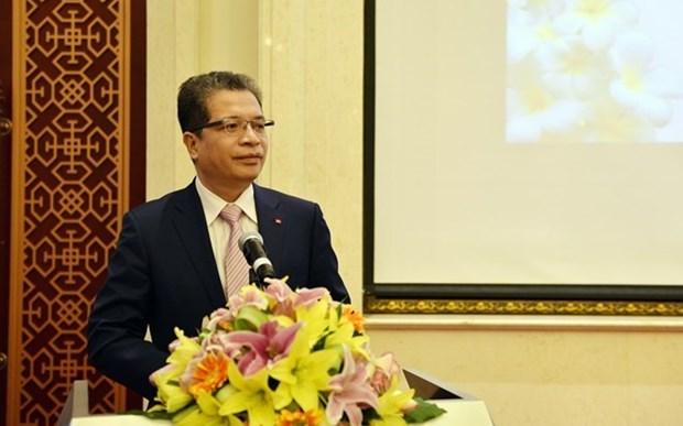 Embajadas de Vietnam y Laos en China mantienen intercambio de amistad hinh anh 1