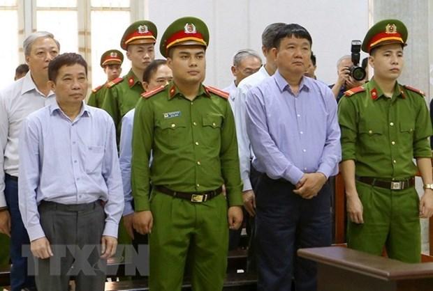 Dinh La Thang condenado a 18 anos de prision por violaciones en PVN y OceanBank hinh anh 1