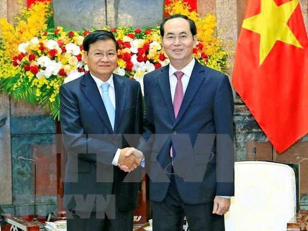 Presidente de Vietnam y primer ministro de Laos se entrevistan en Hanoi hinh anh 1