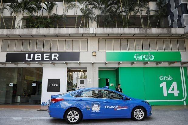 Singapur investiga si pacto de Grab y Uber vulnera ley de competencia hinh anh 1