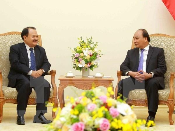 Premier vietnamita recibe al ministro de Energia y Minas de Laos hinh anh 1