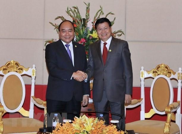 Vietnam y Laos acuerdan impulsar la implementacion de acuerdos sellados hinh anh 1