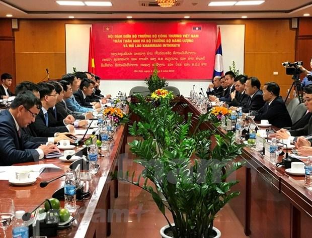 Vietnam y Laos fortalecen cooperacion en sector de energia y mineria hinh anh 1