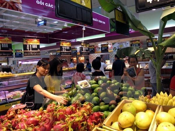 Consumidores vietnamitas optimistas sobre desempeno de la economia nacional, segun encuesta hinh anh 1