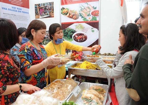Cultura vietnamita seduce a amigos internacionales en Mexico hinh anh 3