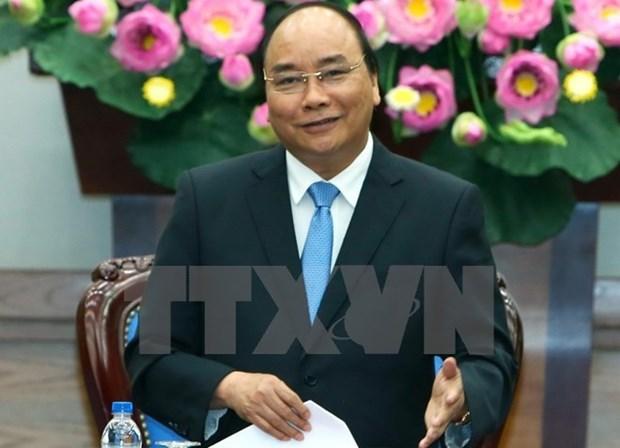Premier de Vietnam visitara Singapur y asistira a Cumbre de ASEAN hinh anh 1